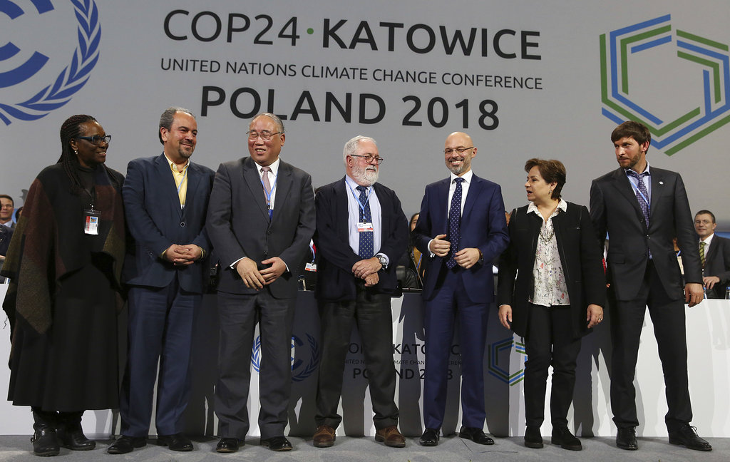 Heads of the delegations react at the end of the final session of the COP24 summit on climate change in Katowice, Poland, Saturday, Dec. 15, 2018.(AP Photo/Czarek Sokolowski)