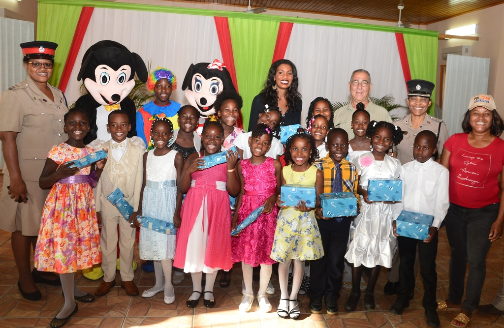 It was bright smiles all around as these excited little ones collected their Christmas presents from New Fortress Energy during a Community Christmas Treat held at the Wembley Community Centre in Halse Hall, Clarendon recently.