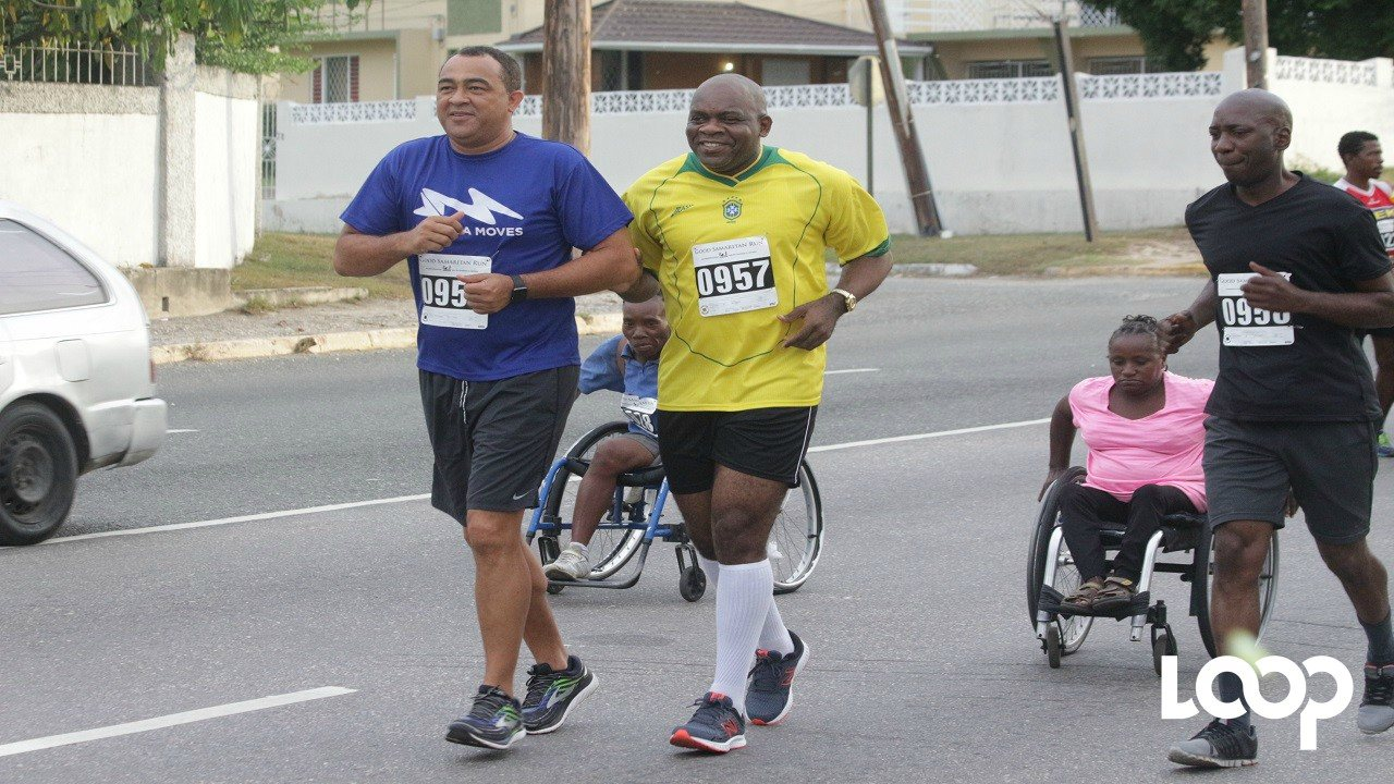 File photo of Health Minister, Dr Christopher Tufton (left), and Senator Floyd Morris (centre), along with other participants, engaged in a road race.