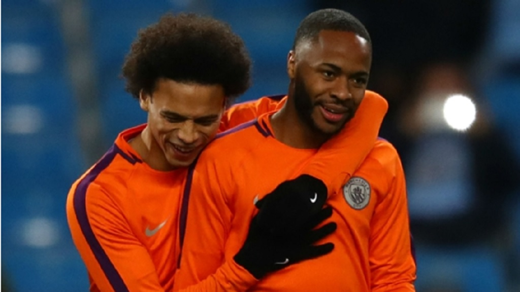 Manchester City team-mates Leroy Sane and Raheem Sterling.
