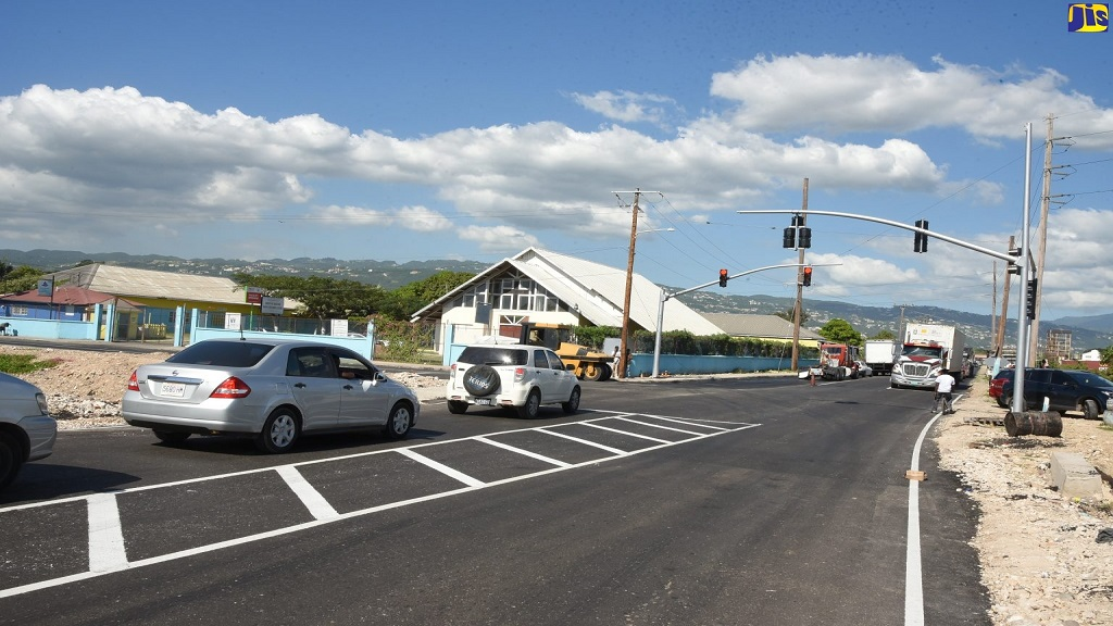 Motorists at one of the signalised points along the new Three Miles bypass road in St Andrew.