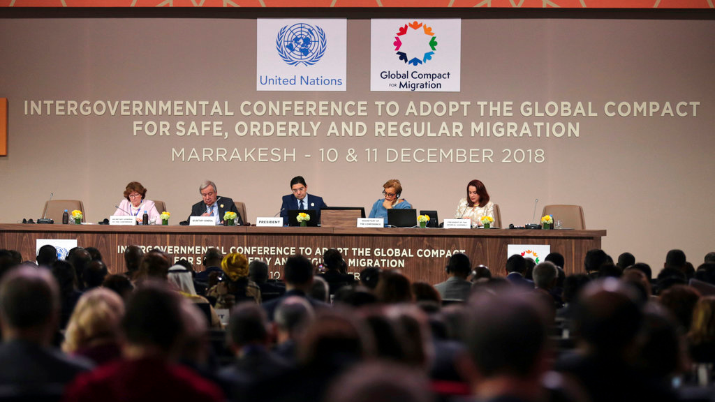 U.N. Secretary-General Antonio Guterres, 2nd left, and Moroccan Minister of Foreign Affairs and International Cooperation, Nasser Bourita, center, chair the opening session of a UN Migration Conference in Marrakech, Morocco, Monday, Dec.10, 2018.