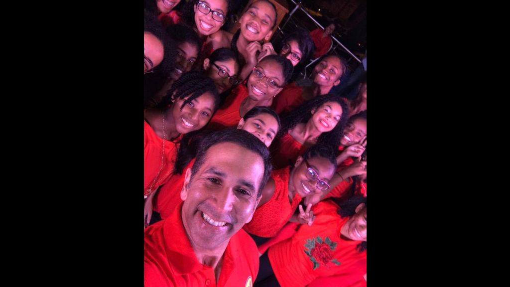 A man of the people: Attorney General Faris Al-Rawi poses for a selfie with constituents at a Christmas event last year.