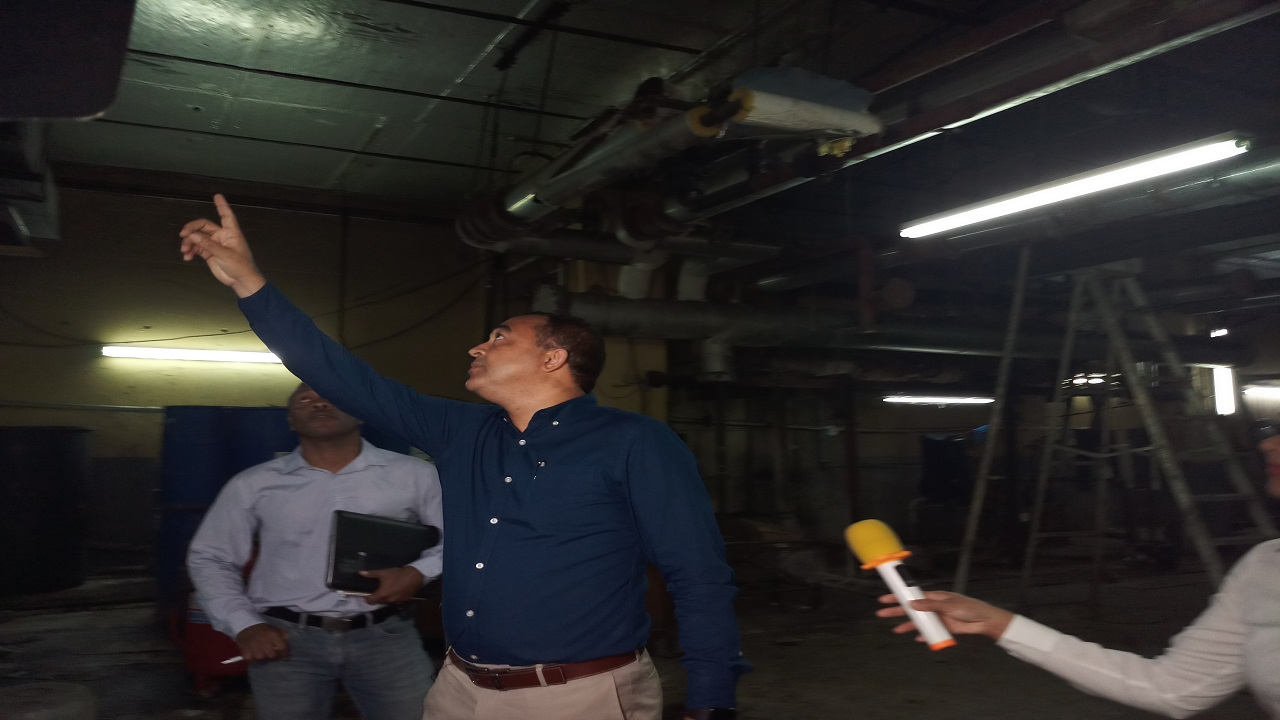 Health Minister, Dr Christopher Tufton (centre), addressing members of the media during a tour of sections of the Cornwall Regional Hospital during an earlier stage of the noxious fumes issue at the Montego Bay-based facility.