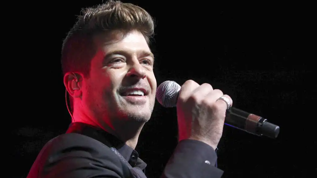 In this Aug. 7, 2015, file photo, Robin Thicke performs during the Steve Harvey Morning Show live broadcast at the Georgia World Congress Center in Atlanta. (Photo by Robb D. Cohen/Invision/AP, File)