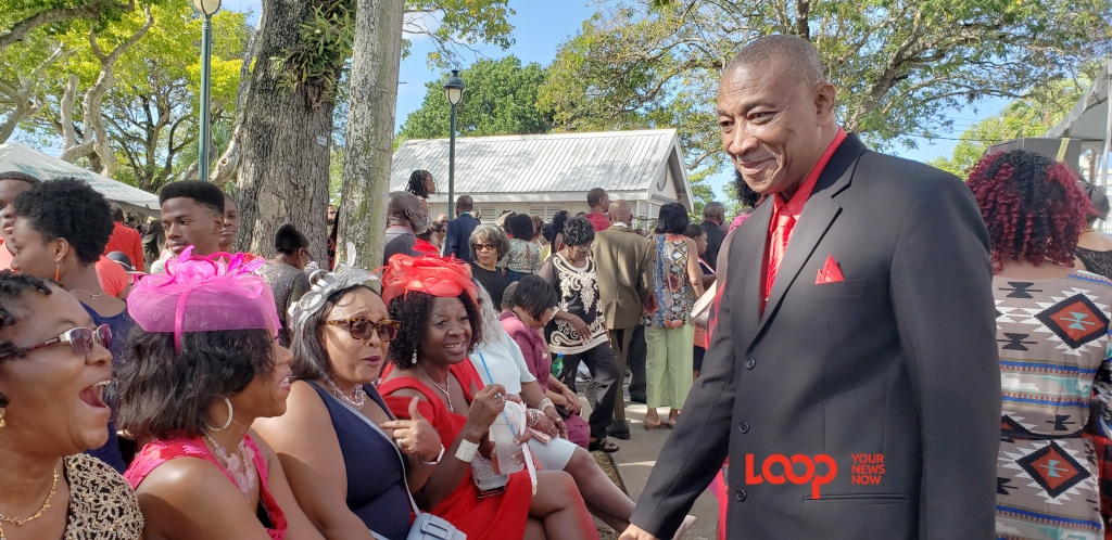 Bishop Joseph Atherley chatting with citizens in Queen's Park on Christmas Day.