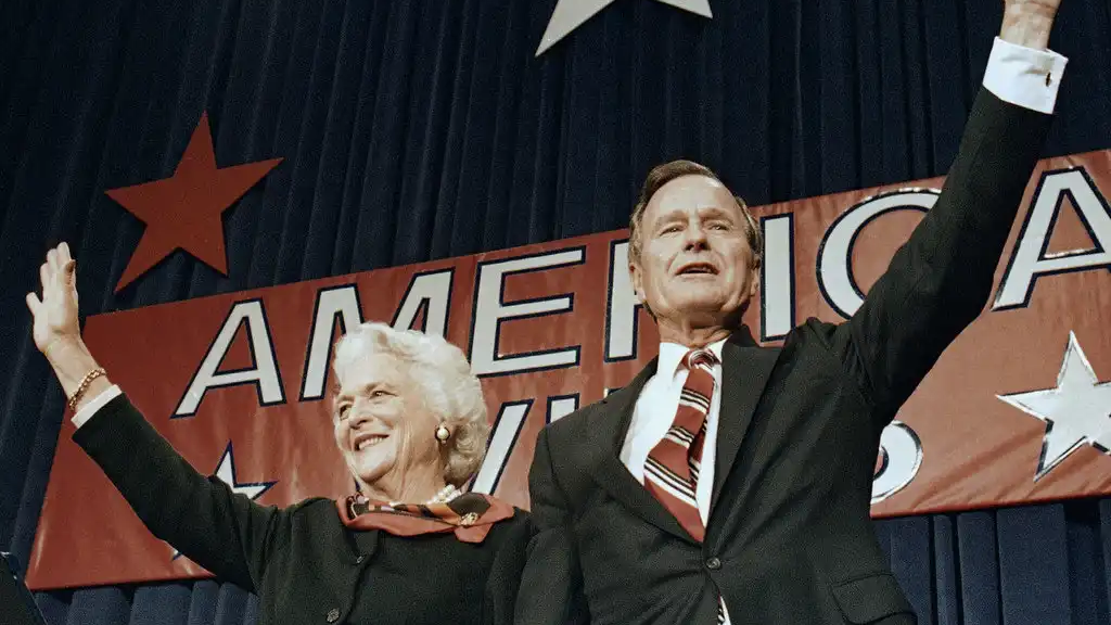 FILE - In this Nov. 8, 1988 file photo, President-elect George H.W. Bush and his wife Barbara wave to supporters in Houston, Texas after winning the presidential election. (AP Photo/Scott Applewhite, File)