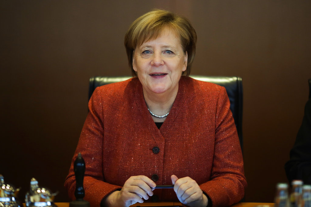 German Chancellor Angela Merkel leads the last cabinet meeting of the German government for this year, at the chancellery in Berlin, Wednesday, Dec. 19, 2018. The German government will decide at the meeting about an initiative to attract foreign skilled workers. (AP Photo/Markus Schreiber)