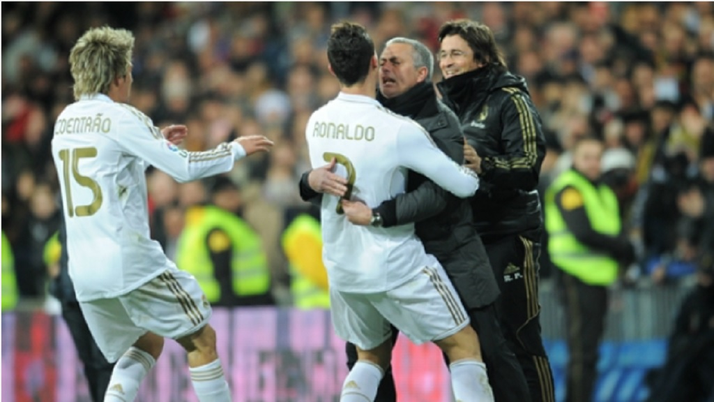 Jose Mourinho celebrates with Cristiano Ronaldo at Real Madrid.