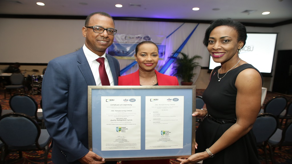 ARC Manufacturing Executive Chairman, Norman Horne, Deputy Managing Director Charlotte Hayles and General Manager of Corporate Affairs, Novlet Deans, celebrate the company's achievement of the ISO 9001:2015 certification with all smiles.