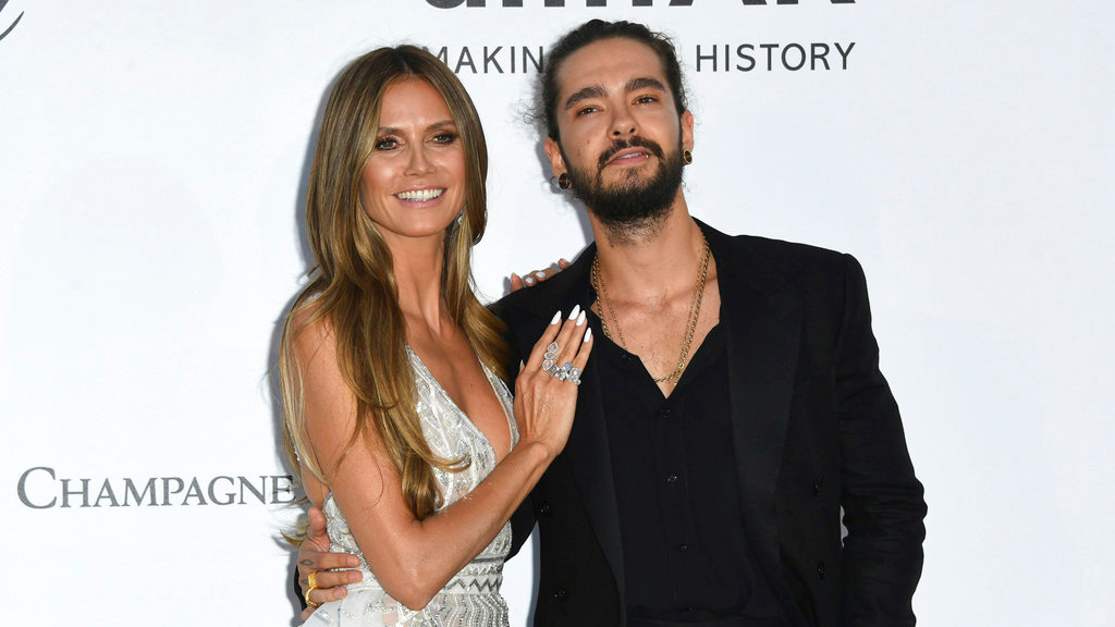 FILE - In this May 17, 2018, file photo, model Heidi Klum, left, and musician Tom Kaulitz pose for photographers upon arrival at the amfAR, Cinema Against AIDS, benefit at the Hotel du Cap-Eden-Roc, during the 71st international Cannes film festival, in Cap d'Antibes, southern France. (Photo by Arthur Mola/Invision/AP, File)