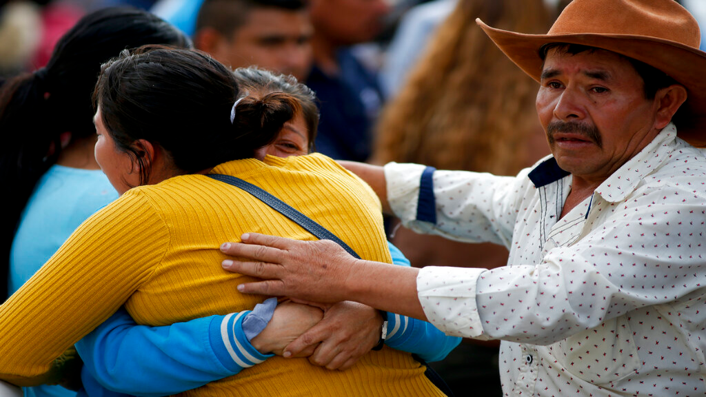 Family embrace outside a funeral service in Tula, Hidalgo state, Mexico, Saturday, Jan. 19, 2019. A massive fireball that engulfed people scooping up fuel spilling from a pipeline ruptured by thieves in central Mexico killed multiple people and badly burned others. (AP Photo/Claudio Cruz)