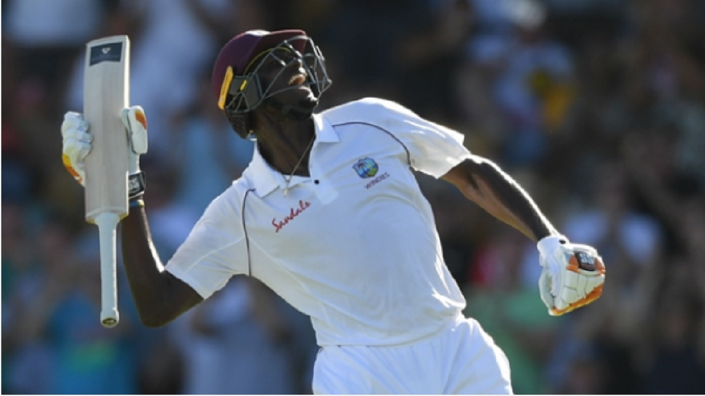 West Indies captain Jason Holder celebrates his 200 against England.