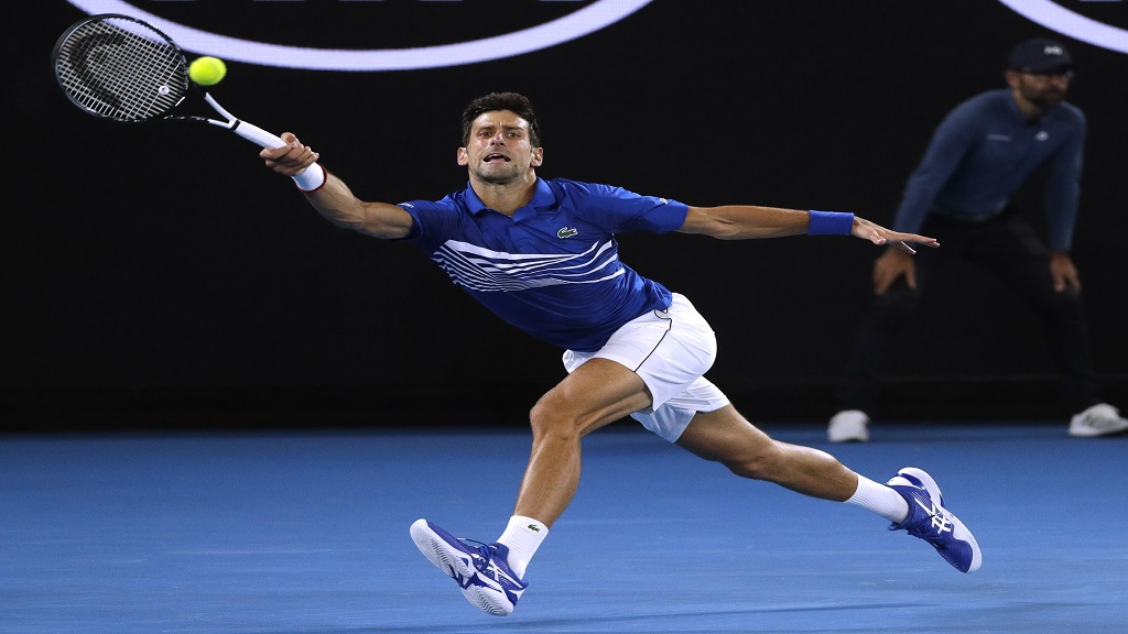 Serbia's Novak Djokovic makes a forehand return to France's Lucas Pouille during their semifinal at the Australian Open tennis championships in Melbourne, Australia, Friday, Jan. 25, 2019.