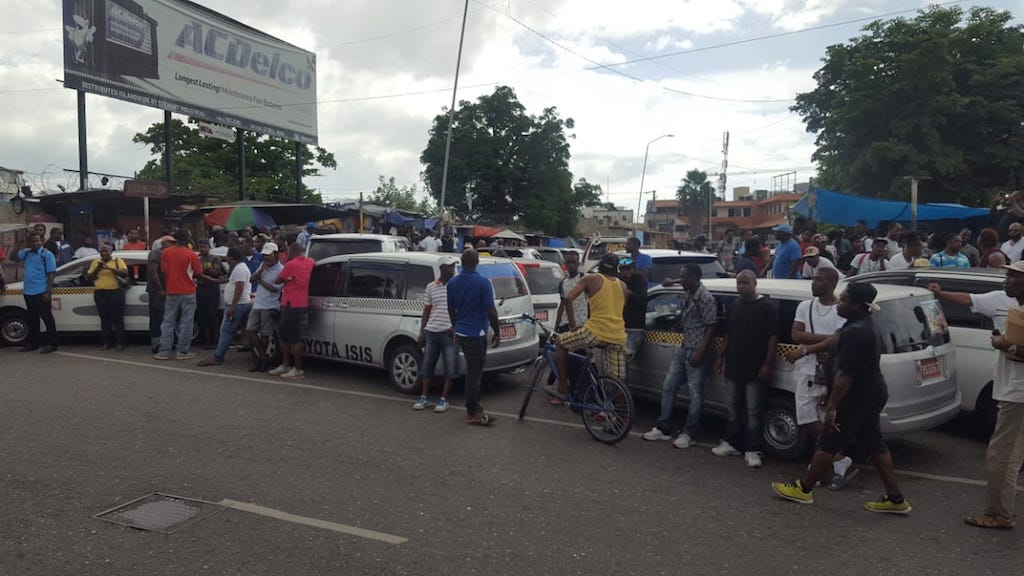 Taxi operators protest in the Corporate Area on Monday.