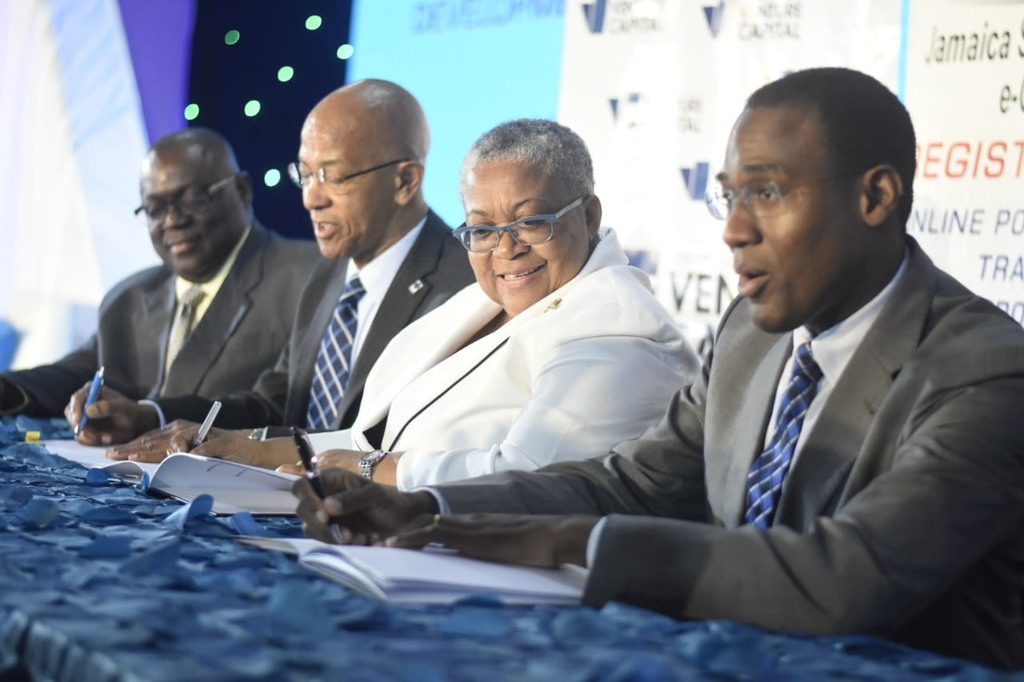 Development Bank of Jamaica and the Jamaica Stock Exchange signed an MOU for the professional course at the JSE's 14th Regional Investment & Capital Markets Conference.