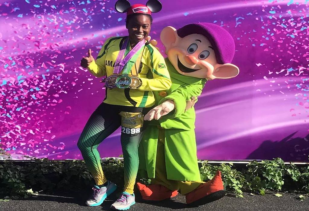 Jamaica's Allison Sutherland poses with a Disney mascot after completing an event at the Dopey Challenge in Orlando, Florida earlier this month. (PHOTO: Facebook)