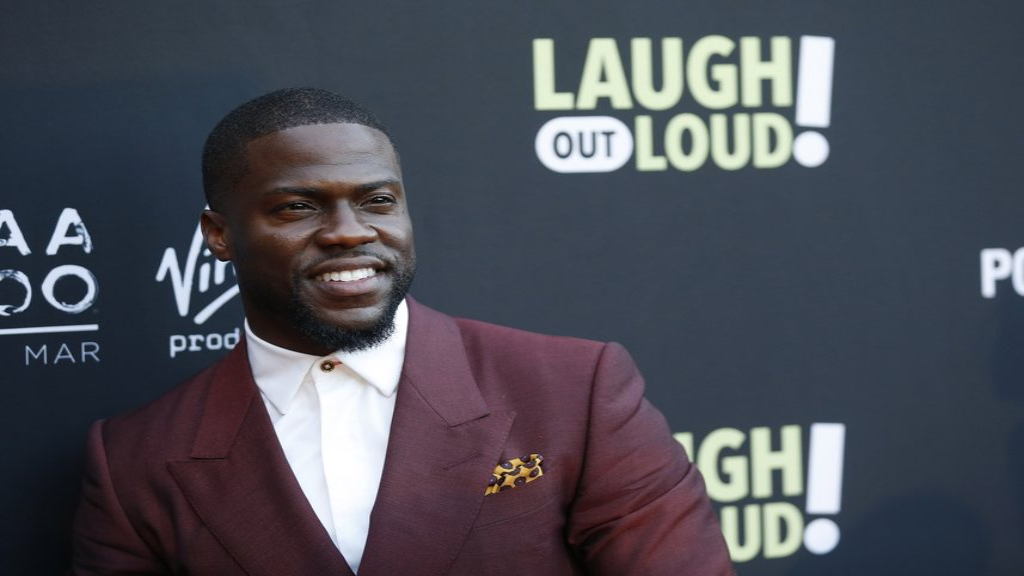 "FILE - In this Aug. 3, 2017 file photo, Kevin Hart poses at Kevin Hart's ""Laugh Out Loud"" new streaming video network launch event at the Goldstein Residence in Beverly Hills, Calif. (Photo by Danny Moloshok/Invision/AP, File)"