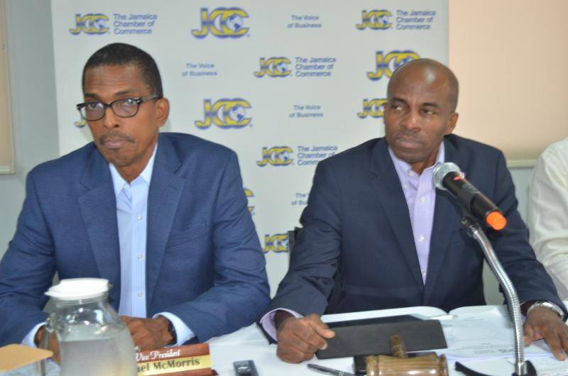 Jamaica Chamber of Commerce 2nd Vice President Ian Nieta (left) and  JCC President Lloyd Distant (right) at the chambers AGM last  year.
