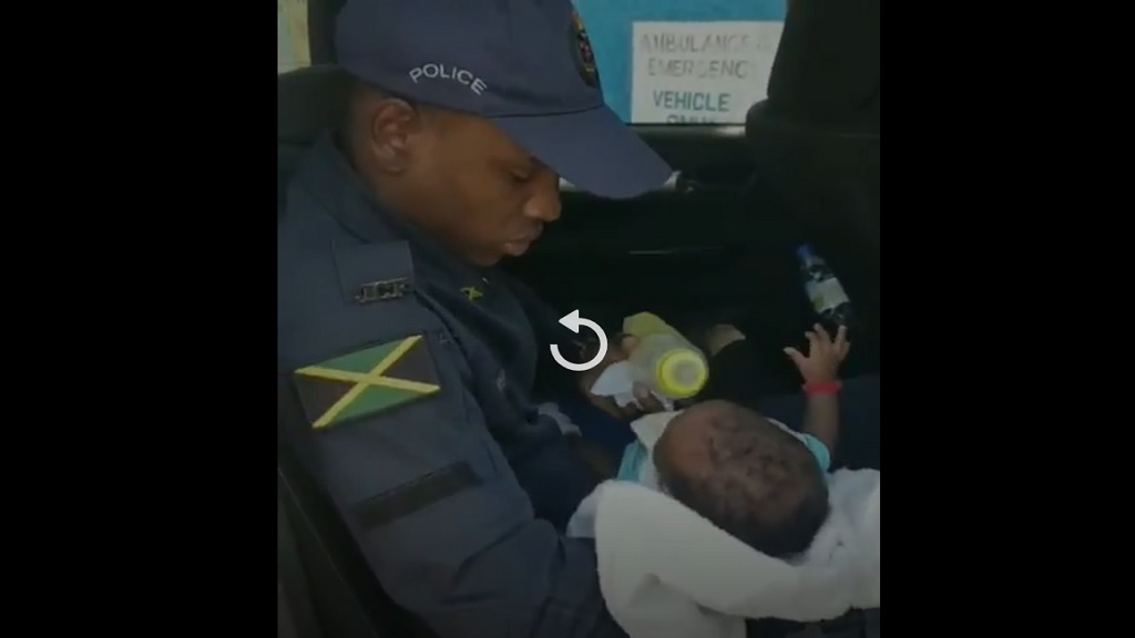 One of the young lawmen who shed their normal policing image in 'rescuing' a mother in deep distress in Kingston on New Year's Eve.