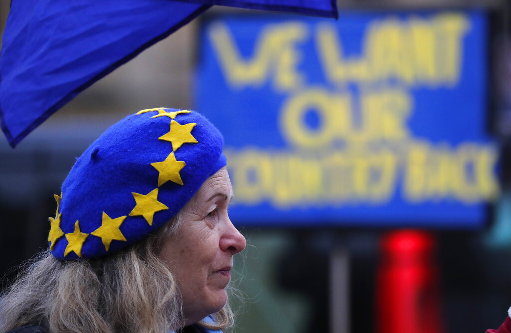 A pro-European demonstrator protests outside parliament in London, Friday, Jan. 11, 2019.  (AP Photo/Frank Augstein)