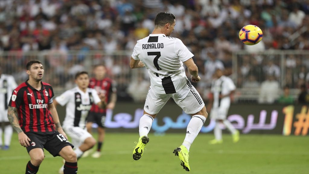 Juventus' Cristiano Ronaldo, right, scores during the Italian Super Cup final against AC Milan at King Abdullah stadium in Jiddah, Saudi Arabia, Wednesday, Jan. 16, 2019.