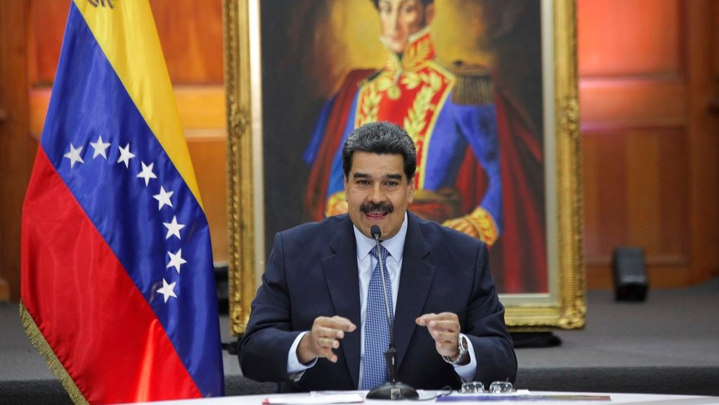 Venezuela's President Nicolas Maduro holds a press conference with foreign media at Miraflores presidential palace where an image of Venezuelan independence hero Simon Bolivar is displayed in Caracas, Venezuela, Wednesday, Jan. 9, 2019. (AP Photo/Boris Vergara)