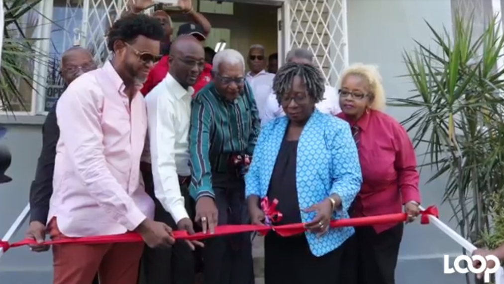 The new Pan Trinbago executive cutting the ribbon to its new office which it will occupy rent-free for a year.