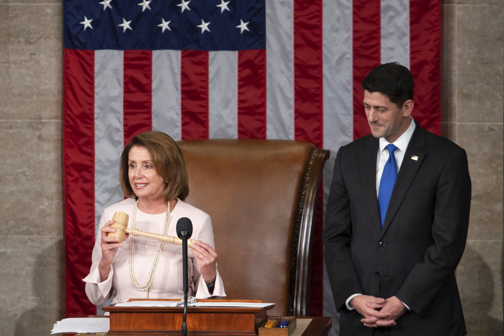 House Democratic Leader Nancy Pelosi of California, left, joins Speaker of the House Paul Ryan, R-Wis., at the start of the 115th Congress, at the Capitol in Washington.  (AP Photo/J. Scott Applewhite, file)