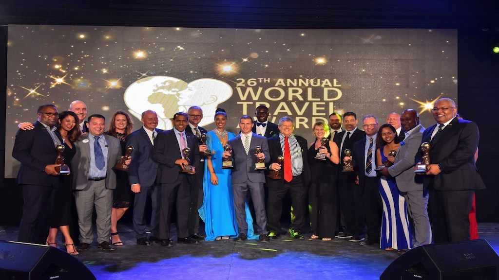"Sandals Resorts chairman Gordon ""Butch"" Stewart and deputy chairman Adam Stewart, along with executives of the hotel chain, are all smiles at the World Travel Awards 2019 on Monday. The resort chain won 11 awards at the ceremony held at the Sandals Montego Bay in Jamaica."