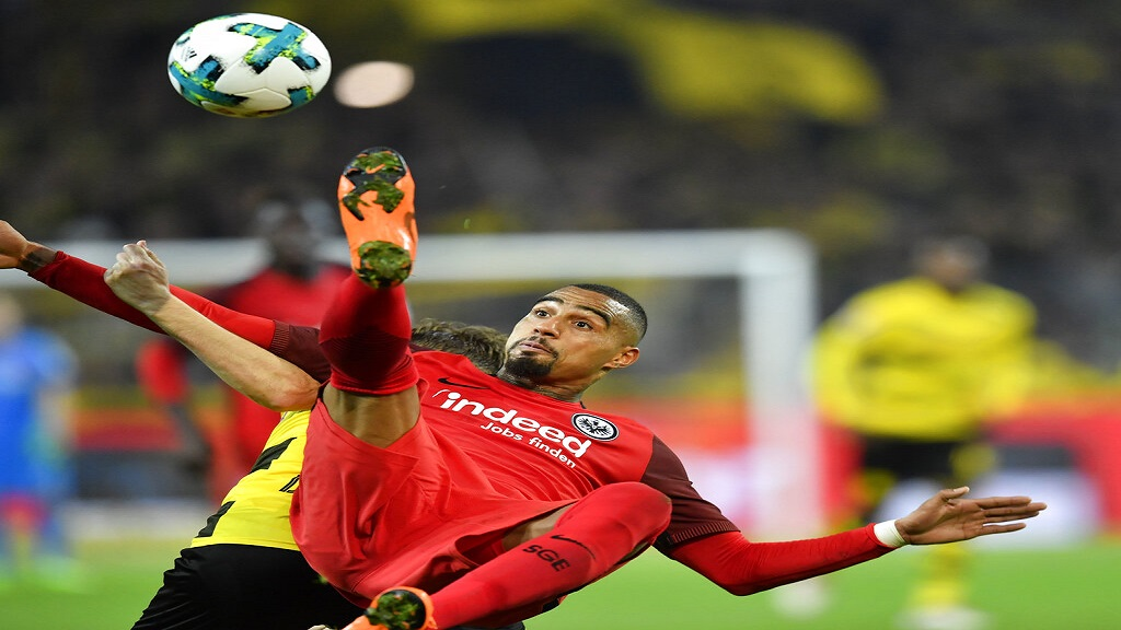 In this file photo dated Sunday, March 11, 2018, Frankfurt's Kevin-Prince Boateng jumps for the ball during the German Bundesliga soccer match between Borussia Dortmund and Eintracht Frankfurt in Dortmund, Germany.  (AP Photo)