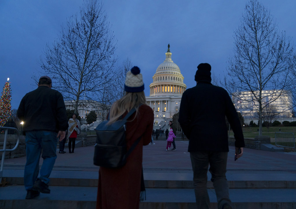 The Capitol is seen as New Year's Day comes to a close with the partial government shutdown in its second week, in Washington, Tuesday, Jan. 1, 2019. (AP Photo/J. Scott Applewhite)