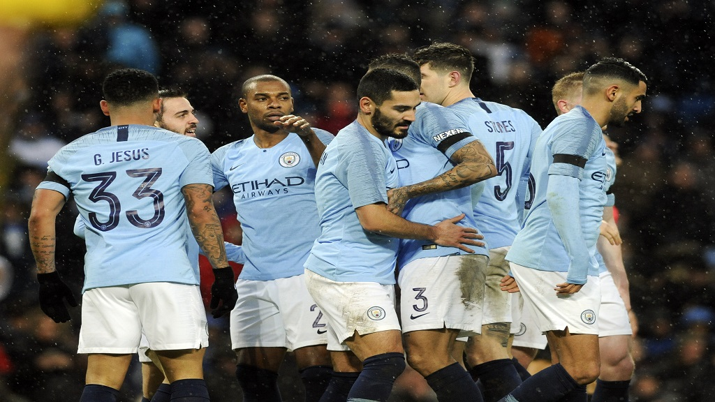 Manchester City's players celebrate after scoring their side's second goal during the FA Cup football match against Burnley at the Etihad stadium in Manchester, England, Saturday, Jan. 26, 2019.