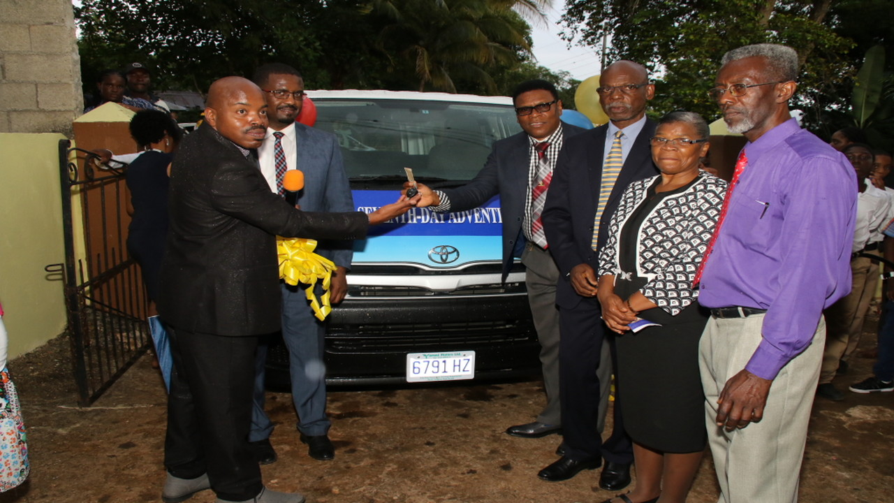 The presentation of a bus from Wheels and Wheels Auto Brokers to the Ramble Seventh Day. (Photos: Llewellyn Wynter) Adventist Church in Porus, Manchester on Saturday.