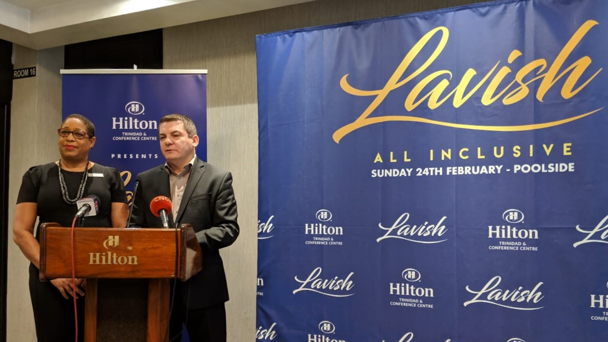 Hilton's Director of Sales and Marketing, Darlene McDonald, left, and Hilton's General Manager, Olivier Maumaire, right, address the media at a media launch for Hilton Trinidad & Conference Centre's all-inclusive event Lavish