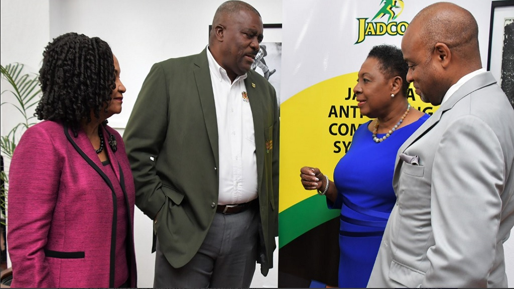 Sport Minister Olivia Grange (second right) in conversation with Raymond Anderson, Vice President, Jamaica Football Federation (second left); June Spence-Jarrett, Executive Director, Jamaica, Anti-Doping Commission (JADCO) and Alexander Williams, Chairman, JADCO at a Symposium organised by JADCO under the theme 'Keeping Sports Clean, Forging Better Partnerships at the Jamaica Conference Centre, downtown, Kingston on January 24, 2019.