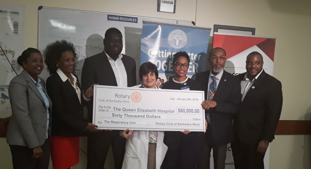 Members of Rotary Club of Barbados West and the QEH Respiratory Unit at the cheque presentation.