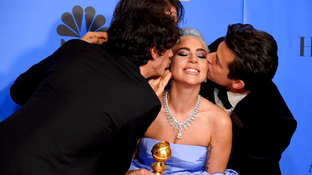 "Anthony Rossomando, from left, Andrew Wyatt, and Mark Ronson, right, kiss Lady Gaga, second right, as they pose in the press room with the award for best original song, motion picture for ""Shallow"" from the film ""A Star Is Born"" at the 76th annual Golden Globe Awards at the Beverly Hilton Hotel on Sunday, Jan. 6, 2019, in Beverly Hills, Calif. (Photo by Jordan Strauss/Invision/AP)"