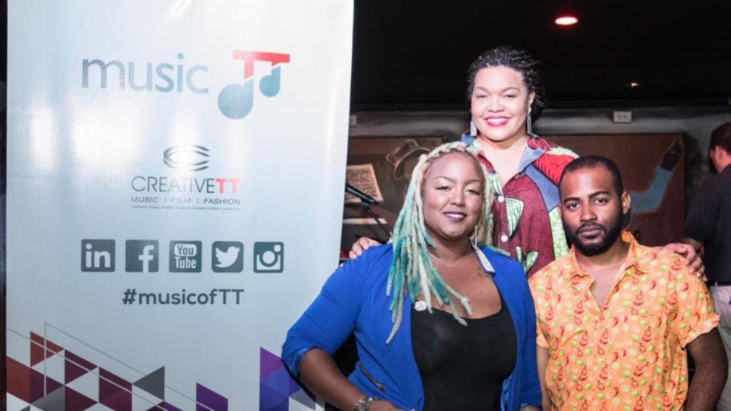 Front from left – DeZii and Daniel Griffith; back- Melissa Jimenez, General Manager, MusicTT