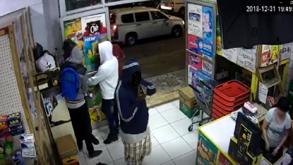 A screenshot from CCTV footage of an armed robbery that took place at a supermarket in Montego Bay, St James on New Year's Eve night.