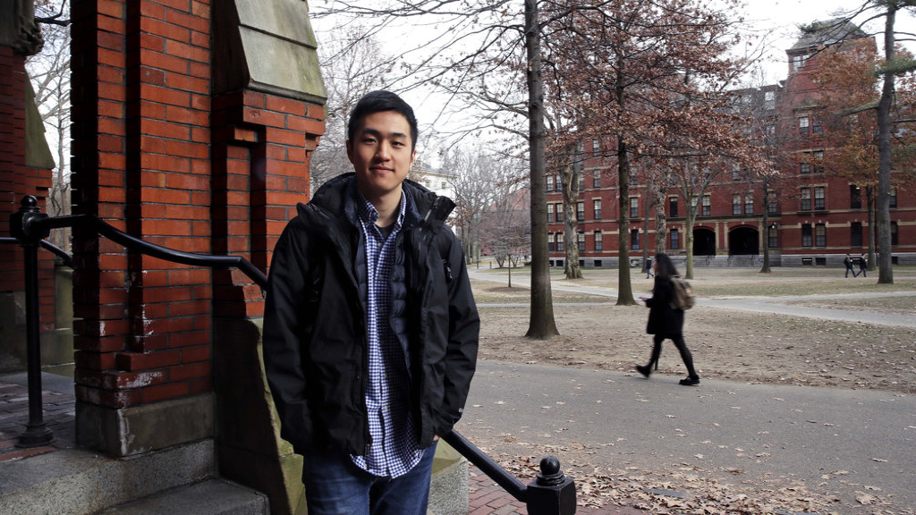 Harvard University graduate Jin K. Park, who holds a degree in molecular and cellular biology, poses at Harvard Yard in Cambridge, Mass., Thursday, Dec. 13, 2018. (AP Photo/Charles Krupa)
