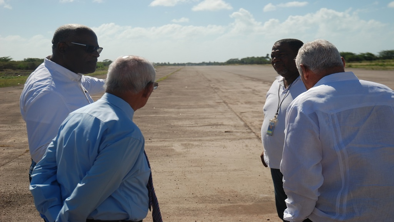 Minister without Portfolio in the Office of the Prime Minister (OPM), Mike Henry (right), in discussion with (left to right) Lieutenant Colonel Oscar Derby, Project Manager for the Vernamfield development; businessman Dennis Lalor; and Vernal Angus, Project Manager of the Airports Authority of Jamaica (AAJ), on the main runway at the Vernamfield aerodrome in South West Clarendon recently. 