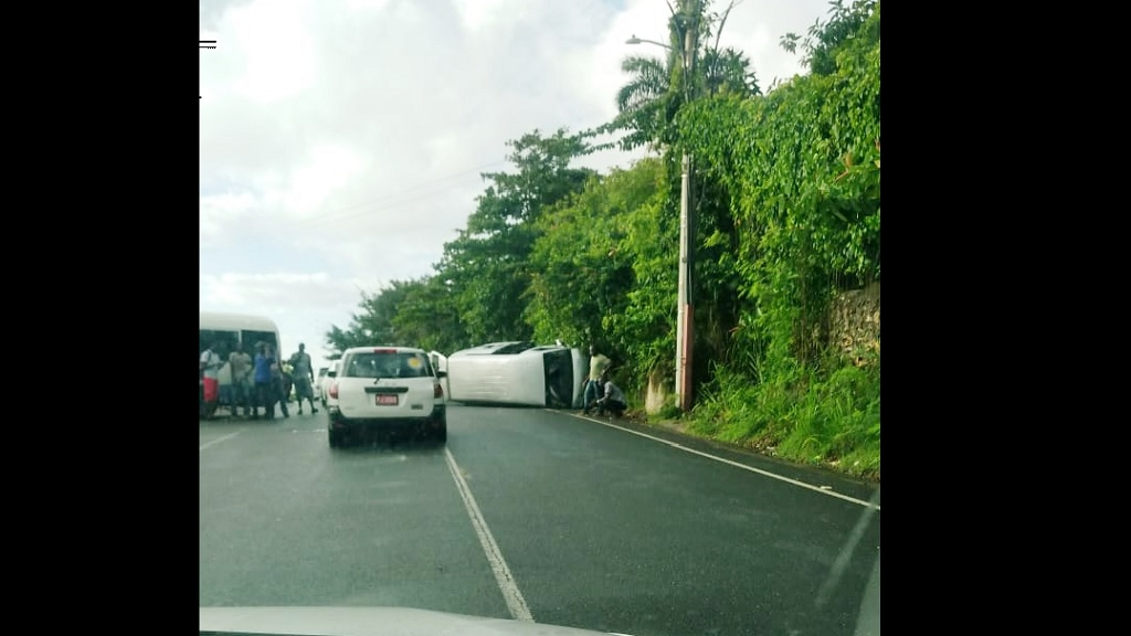The overturned minibus at the scene of Monday morning's two-bus crash on the Galina main road in St Mary.
