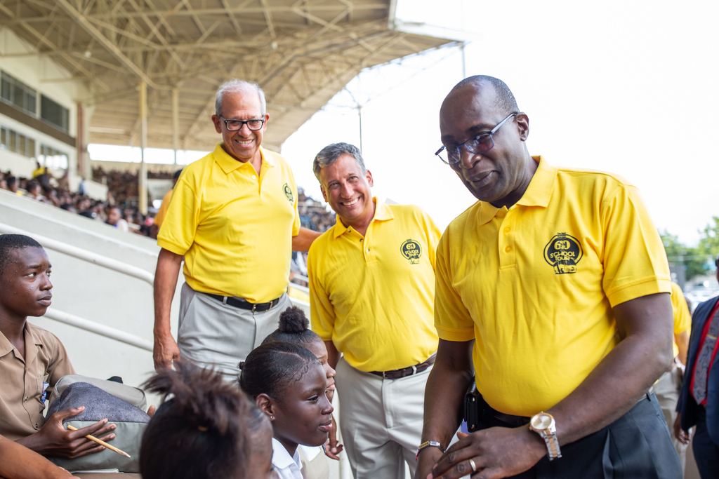 Minister of Education, Youth and Information, Senator Ruel Reid (right), greets students from Holy Trinity High at the launch of the Best Dressed Chicken 60 School Tour. Looking on are Robert Levy (left), Chairman, Jamaica Broilers Group and Group President and CEO, Christopher Levy (centre).