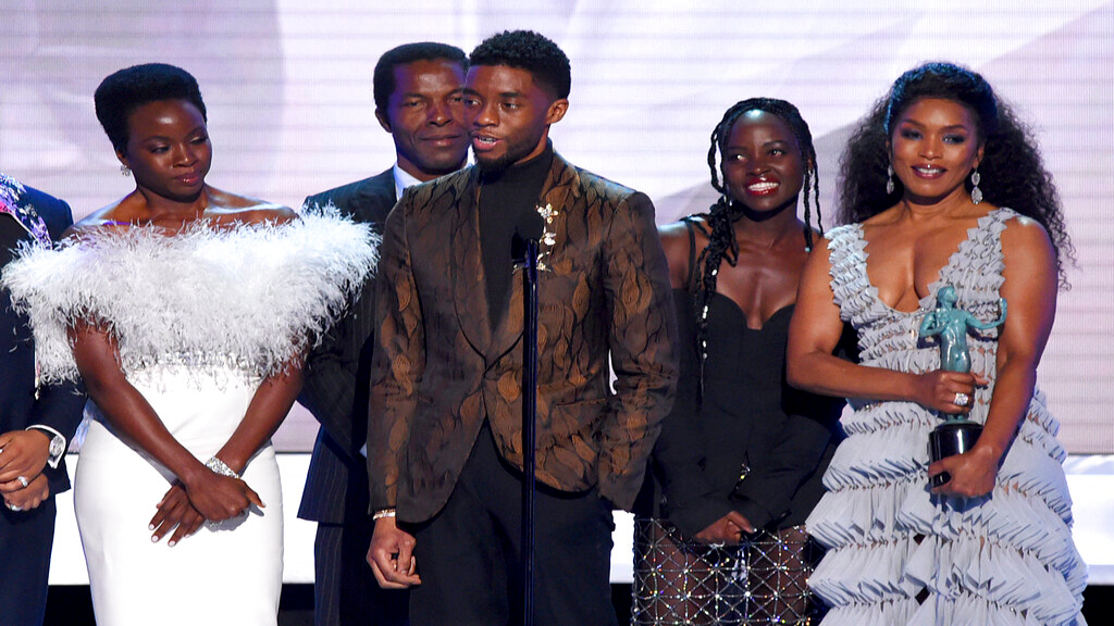 "Danai Gurira, from left, Isaach de Bankole, Chadwick Boseman, Lupita Nyong'o and Angela Bassett from the cast of ""Black Panther,"" accept the award for outstanding performance by a cast in a motion picture at the 25th annual Screen Actors Guild Awards at the Shrine Auditorium & Expo Hall on Sunday, Jan. 27, 2019, in Los Angeles. (Photo by Richard Shotwell/Invision/AP)"