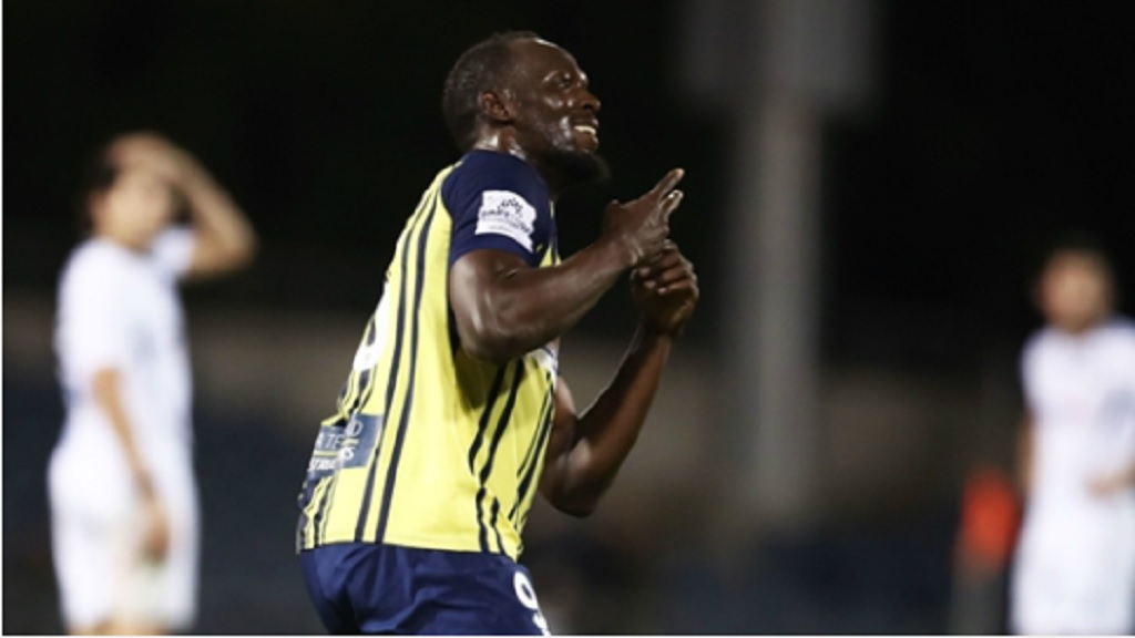 Usain Bolt celebrates scoring for  Central Coast Mariners.