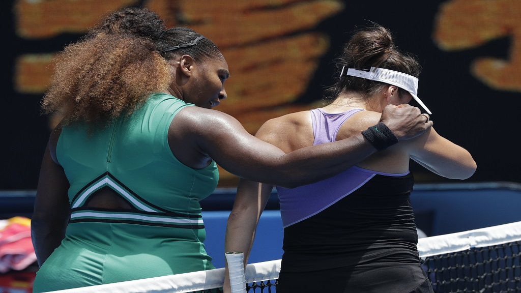 United States' Serena Williams, left, embraces Germany's Tatjana Maria at the net following their first round match at the Australian Open tennis championships in Melbourne, Australia, Tuesday, Jan. 15, 2019.