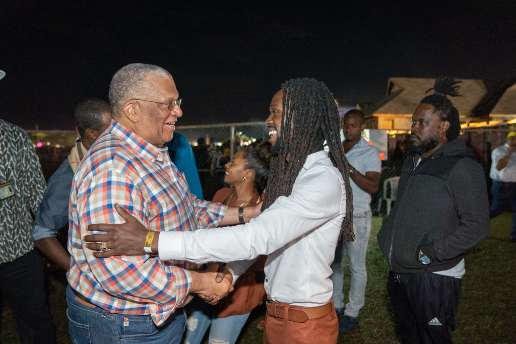 Opposition leader Dr Peter Phillips greets reggae singer Jesse Royal at Rebel Salute.