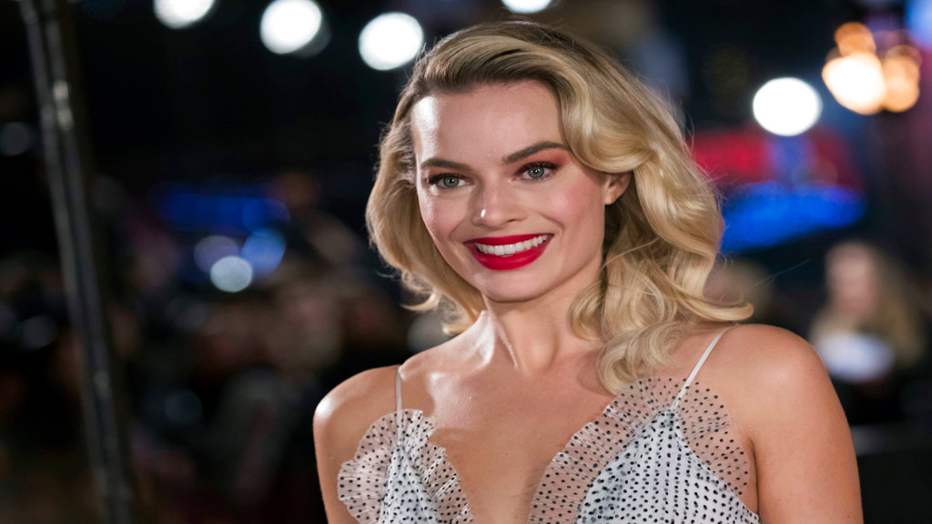 "FILE - In this Monday, Dec. 10, 2018, file photo, actress Margot Robbie poses for photographers upon her arrival at the premiere of the film ""Mary Queen of Scots,"" in London. (Photo by Vianney Le Caer/Invision/AP, File)"