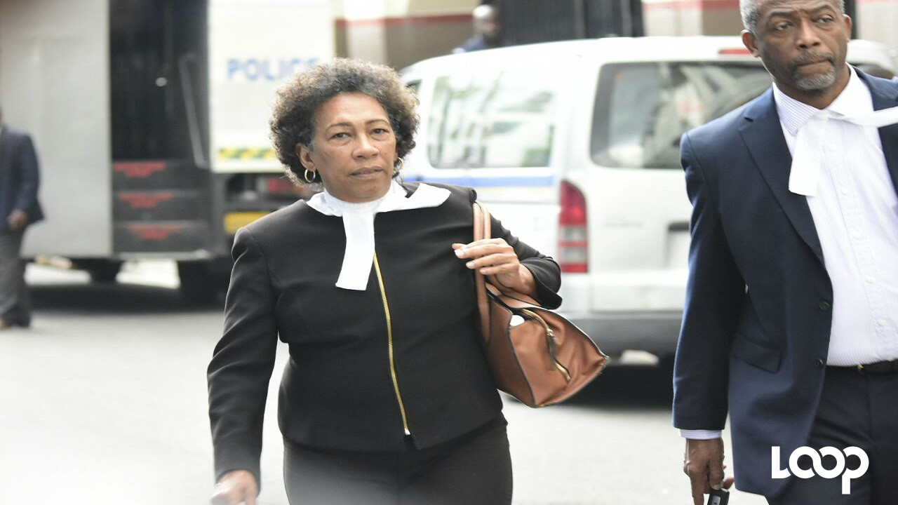 Queen's Counsel Valerie Neita Robertson makes her way to court on Monday ahead of the verdict in the Ninjaman murder trial. (PHOTO: Marlon Reid)